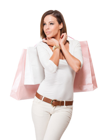 Portrait of  a gorgeous happy young brunette woman with shopping bags. photo