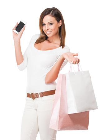 shopper: Portrait of a cool happy shopper young brunette woman. Stock Photo