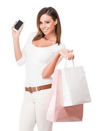 Portrait of a cool happy shopper young brunette woman. Stockfoto