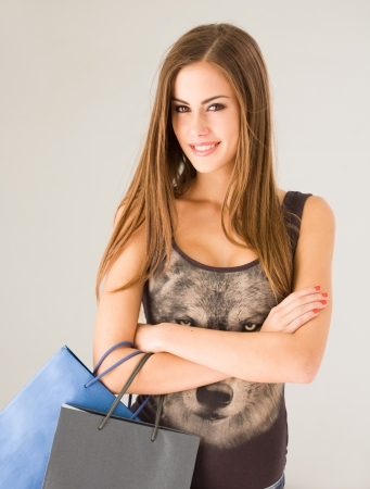 Portrait of a cute attractive young shopper girl. photo