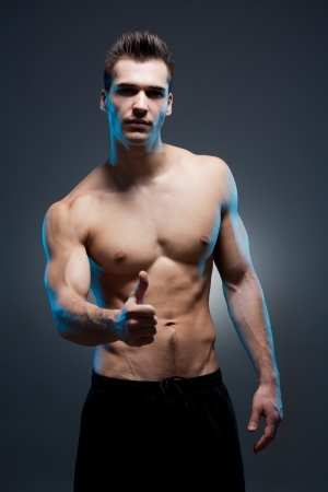 Moody portrait of a very fit lean young brunette man. Stock Photo
