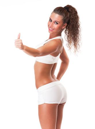 culo di donna: Ritratto di una giovane donna bruna felice con il corpo in forma perfetta. Archivio Fotografico