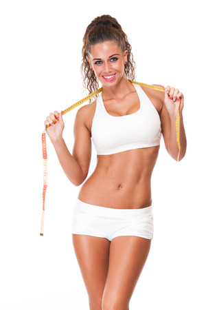perfect fit: Portrait of a happy young brunette woman with perfect fit body. Stock Photo