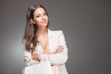 Portrait of a beautiful fashionable young shopper woman. Stock Photo - 23217580