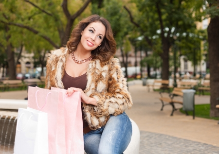 Portrait of a fashionable atrractive young brunette shopping woman. photo