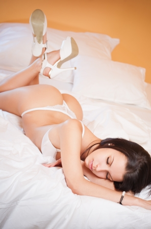 Portrait of a dreamy sensual lingerie beauty in bed. photo