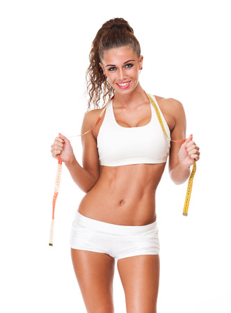 perfect fit: Gorgeous young brunette showing off perfect fit body. Stock Photo