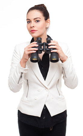 Portrait of a beautiful young businesswoman with binoculars. photo