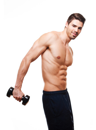triceps: Portrait of a very fit handsome young athlete. Stock Photo
