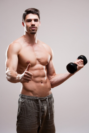 Portrait of a very fit handsome young athlete. Stock Photo