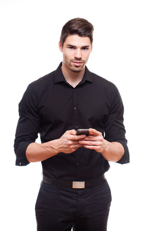 cute guy: Portrait of a smart young businessman using his smartphone. Stock Photo