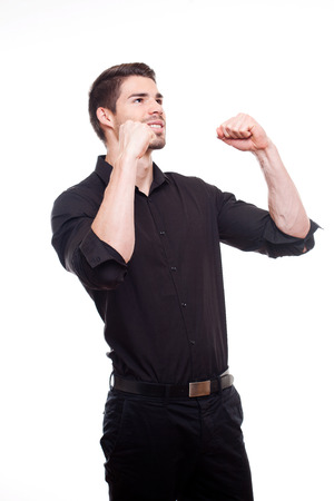 exuberant: Portrait of an exuberant cool young businessman gesturing in victory.