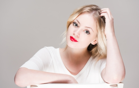 fair skinned: Portrait of a fair skinned blond beauty with bright red lips.