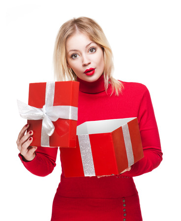 Portrait of a beautiful young blond woman holding shiny red gift box. photo