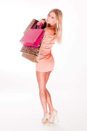 full figure: Full figure portrait of beautiful sexy blond woman with colorful shopping bags. Stock Photo