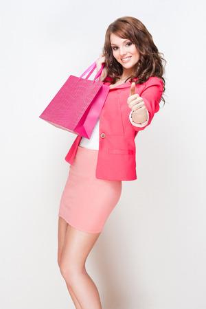 Portrait of an attractive young brunette shopper woman. photo