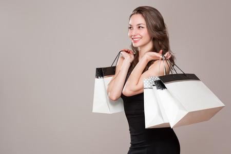 Portrait of a gorgeous elegant young brunette shopper.