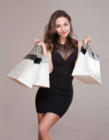 Portrait of a gorgeous elegant young brunette shopper. photo