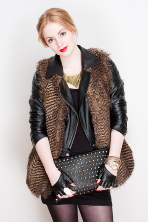 Portrait of a very stylish fashionable young blond woman. photo
