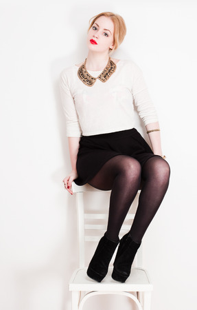 the girl in stockings: Portrait of a very stylish fashionable young blond woman. Stock Photo