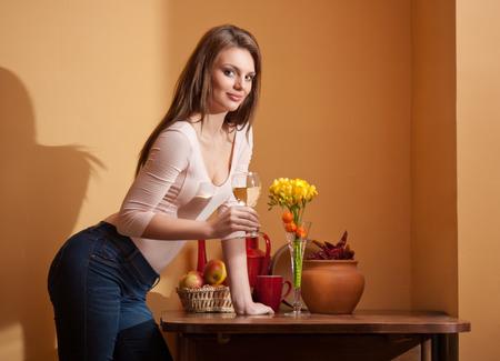 sauvignon blanc: Portrait of a gorgeous young brunette woman having wine.