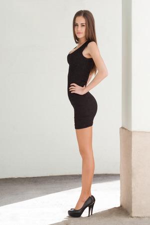 high heels: Portrait of a gorgeous fashionable slim brunette beauty.