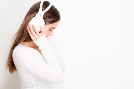 sexy headphones: Portrait of a beautiful young brunette woman listening to music in headphones.