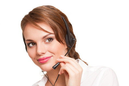 Portrait of a gorgeous young brunette woman wearing headset. photo