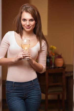 sauvignon blanc: Portrait of a gorgeous young brunette woman enjoying wine.