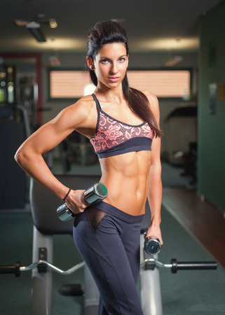 Portrait of a gorgeous young brunette woman working out. photo