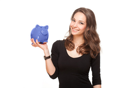 Portrait of a gorgeous young brunette woman with shiny piggy bank. Stock Photo - 28402942