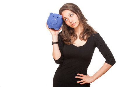 Portrait of a gorgeous young brunette holding piggy bank isolated on white background. photo