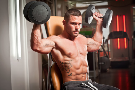 six persons: Portrait of a super fit young man working out. Stock Photo
