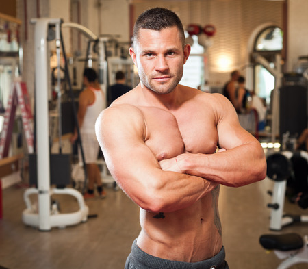 upper half: Portrait of a super fit young man working out. Stock Photo
