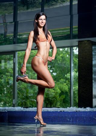 Portrait of a slender super fit young brunette woman. Stock Photo