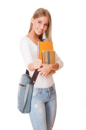 練習帳と魅力的な若い学生の肖像画。