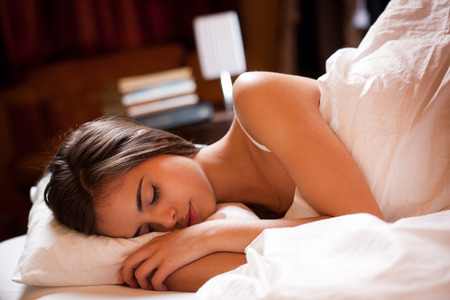 Gorgeous young brunette having a good nights sleep. photo