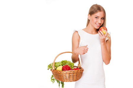 Portrait of a beautiful young blond woman with basket full of healthy groceries. photo