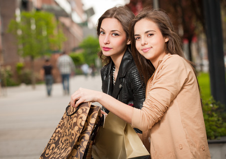 beauties: Fashionable shopping beauties outdoors in the city.