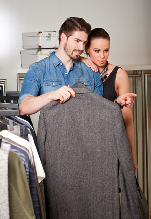Very attractive, young and fashionable couple shopping clothes. photo