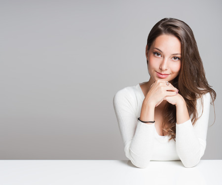 Portrait of a beautiful young cheerful burnette woman. Stock Photo