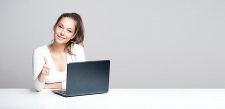 asian on laptop: Portrait of a young brunette beauty with her laptop.
