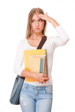 forgetful: Portrait of a blond attractive young student with exercise books. Stock Photo