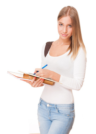 Portrait of a blond attractive young student with exercise books. photo