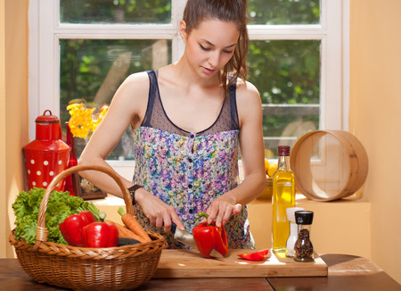 virgin girl: Portrait of a gorgeous brunette preparing healthy meal in the kitchen. Stock Photo