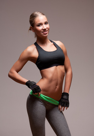black bra: Portrait of a fit and healthy young blond woman in fitness outfit.