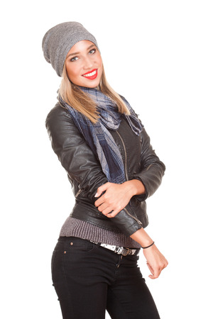 Portrait of a winter fashion blond woman on white background. photo