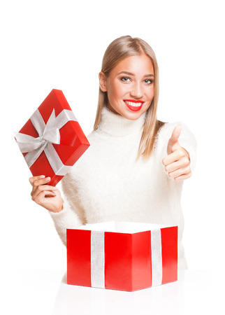Portrait of a gorgeous young blond woman with bright red gift box. photo