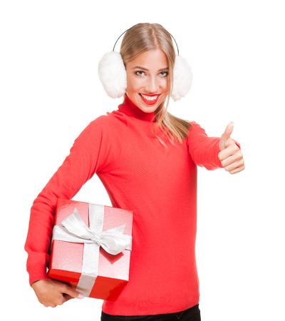 Beautiful young blond woman holding shiny red christmas gift box. photo