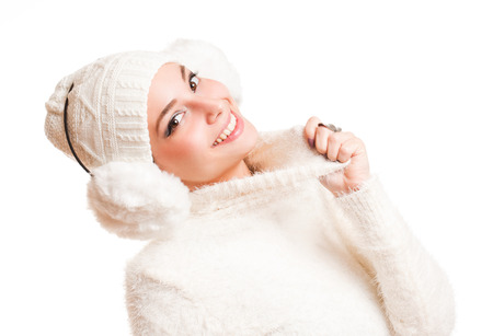 Gorgeous happy young brunette in warm winter weather clothes. photo
